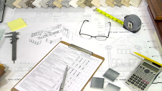 Blueprints, Home Plans, Renovation Material Selection on Architects Desk video