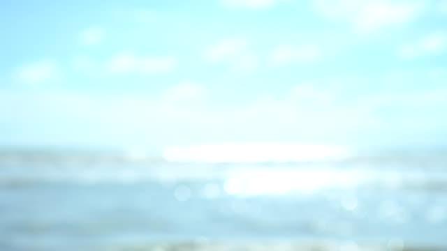 Blur beautiful tropical beach in summer season with blue sky.