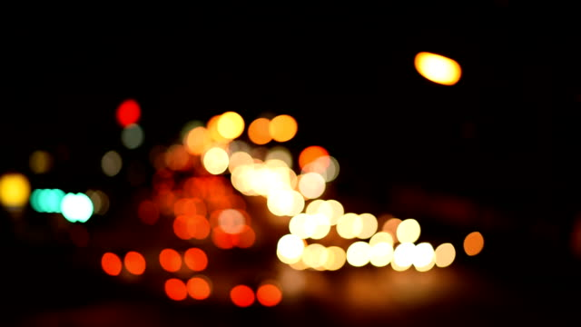 blur bokeh night traffic lights street - abstract background - bokeh stock videos & royalty-free footage