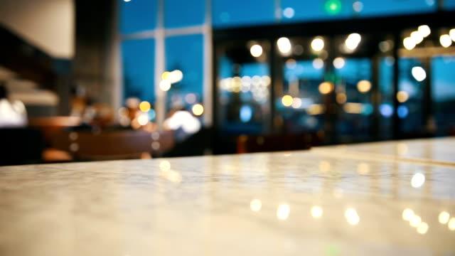 vídeos de stock e filmes b-roll de blur cafe (bar) with light background - coffee table