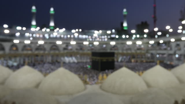 Blur for background Group of Islamic during Prayer in Mecca saudi arabia video