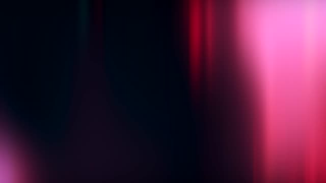 blur glow motion festive glare pink bokeh lights Blur glow motion. Festive glare. Pink bokeh lights on dark background. leaking stock videos & royalty-free footage