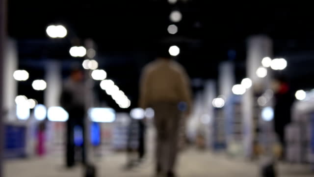 Video Blur motion of people shopping inside an electric store with 4k resolution