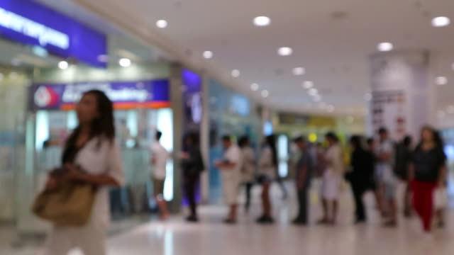 blur or defocus background of people line up to use banking machine or atm(automatic teller machine) to deposit, withdraw and transfer money - banks and atms stock videos & royalty-free footage