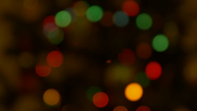 blurred christmas lights bokeh, low loght tone. copy space for creative design. - bokeh stock videos & royalty-free footage