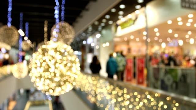 vídeos de stock e filmes b-roll de blurred christmas shopping mania in big black friday sales - black friday