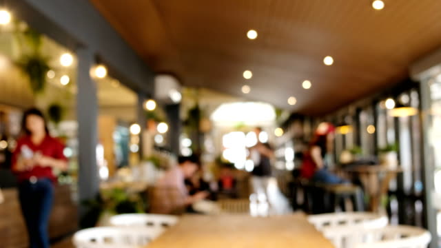 blurred coffee shop blurred background of people shopping in coffee shop. wait staff stock videos & royalty-free footage