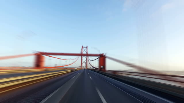 Blurred Driving on Abril Bridge in Lisbon Blurred Driving on a 25 de Abril Bridge in Lisbon, sunny weather ponte 25 de abril stock videos & royalty-free footage