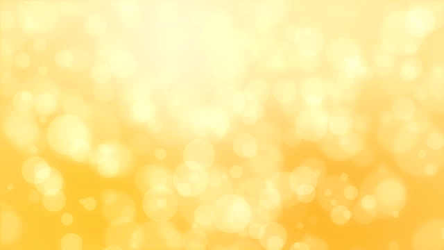 blurred golden yellow bokeh background - soft focus video stock e b–roll