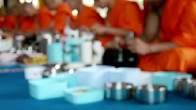 Blurred motion of the monks eating food and drink  in traditional religious ceremony in a temple , Thailand. video