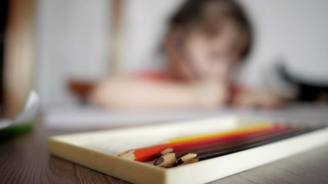 blurred of child draws with pencils blurred of child draws with pencils, selective focus autism stock videos & royalty-free footage