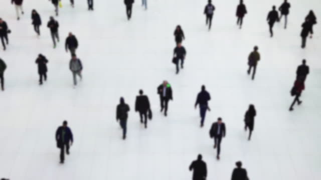 blurred of top view people walking on white floor or large crownd of anomymous moving in transportation hub in modern hall center in urban city - pedone ruolo dell'uomo video stock e b–roll