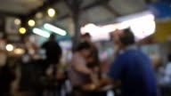 istock 4K: Blurred, people in modern restaurant. 1185781447