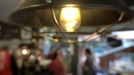 istock 4K: Blurred, people in modern restaurant. 1186250376