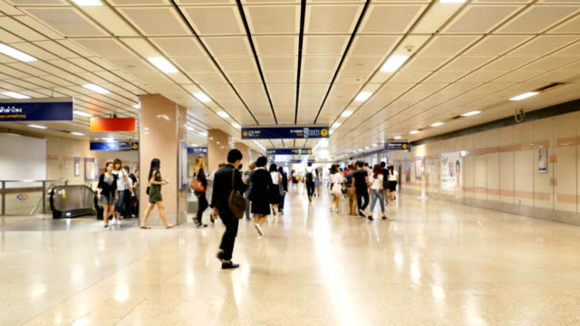 Blurred people on subway platform video