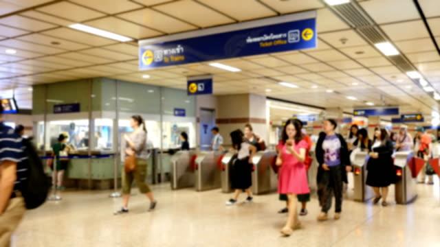 Blurred people queue on subway station platform video