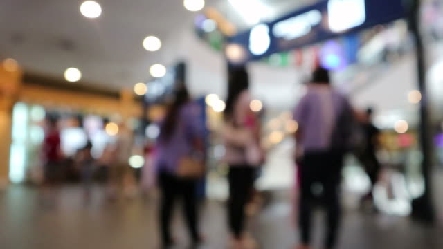 Blurred, People walking and shopping in mall Blurred, People walking and shopping in mall shopping mall stock videos & royalty-free footage