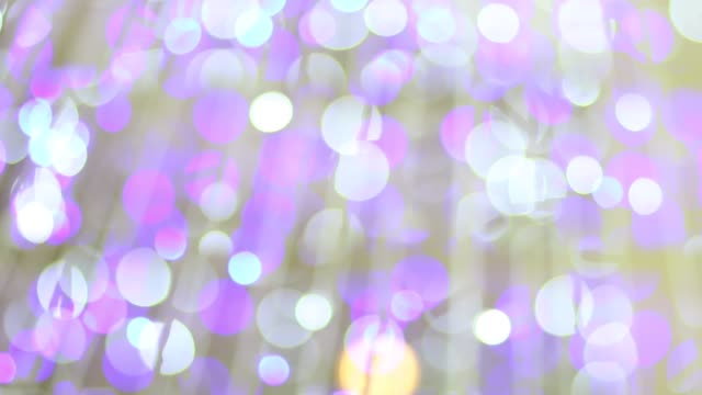 Blurred purple glitter vintage Blinking christmas lights LED bulbs motion, Close up of big bokeh lights loopable background, Defocused or Abstract Neon lights. video