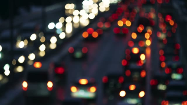 ld blurred rear car lights of the heavy traffic on the highway - traffic filmów i materiałów b-roll