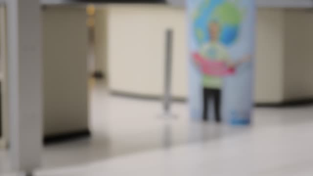 Blurred retail store in Europe. Corridor behind the checkout counter in local supermarket, defocused background video