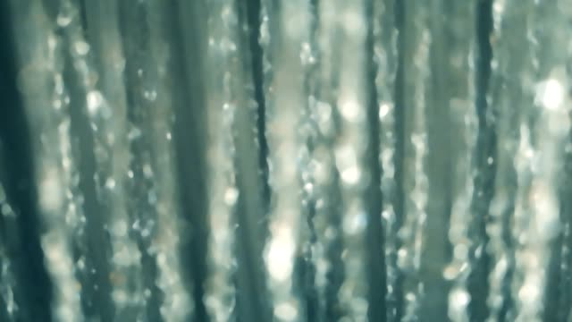 Bидео Blurred Shower flowing close up, slow motion, Falling water drops slow motion