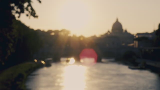 Blurred video of a wonderful view of a sunset that is coming down behind the great St. Peter's Basilica in Rome, Italy. video