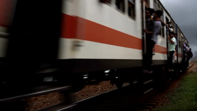 blurry fast train with people hanging out video