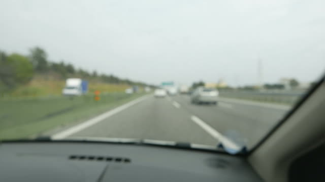 Blurry traffic on highway from passenger point of view. Slow motion. video