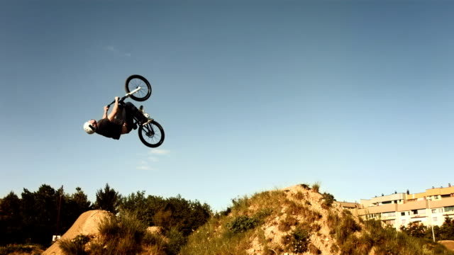 HD SLOW MOTION: Bmx Rider Doing Backflipping Dirt Jump video
