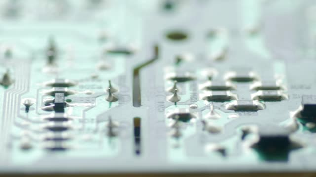 PCB Board Microcircuit Close up by Macro lens , Sliding by dolly video