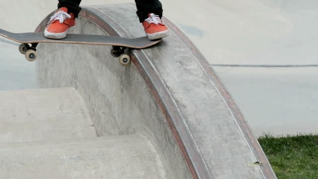 Boarder practicing skateboard tricks in a skate park video