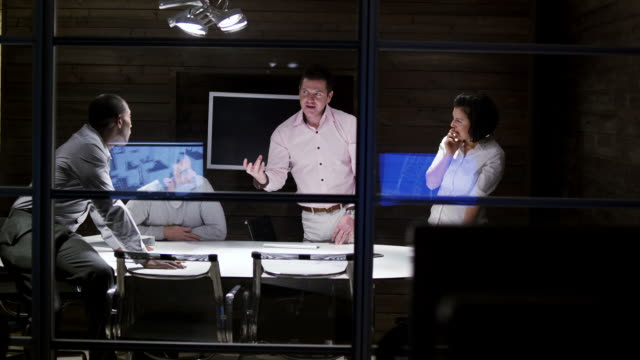 Boardroom office meeting in the evening video