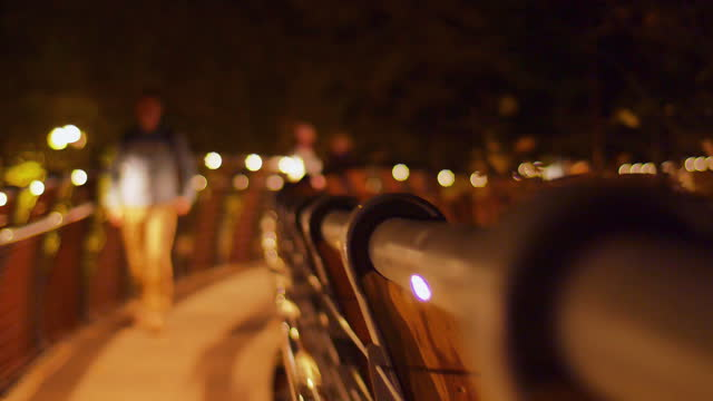 Boardwalk in a park at night