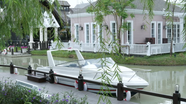 Boat at riverfront Boat at riverfront military private stock videos & royalty-free footage