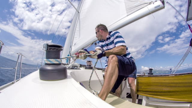 WS Boat Crew Working On A Sailboat video