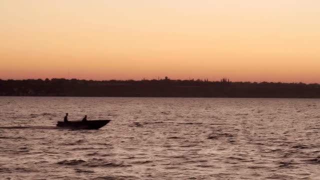Boat crossing lake video