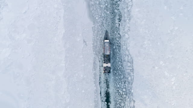 Boat Float on the Surface of a Frozen Lake Baikal. Travel Concept Winter Landscape Top View Drone Footage polar climate stock videos & royalty-free footage