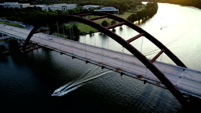 Boat going Under Suspension Bridge in Austin , Texas
