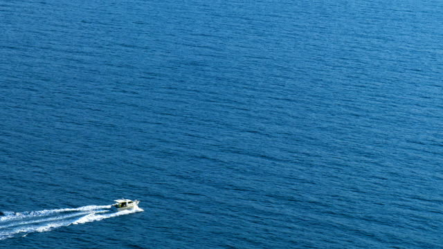 Boat moves on the sea, aerial view. video