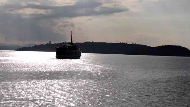 Boat navigates to an island on a lake