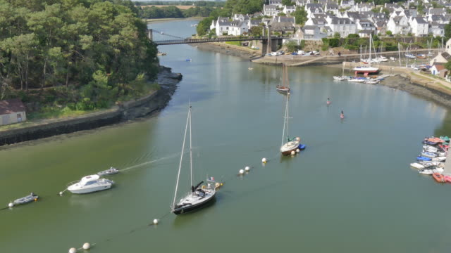 boat sailing  and people Paddleboarding in the delta of Bono, Brittany video