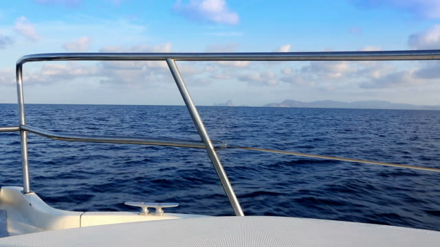 boat sailing in blue mediterranean sea on ibiza islands video