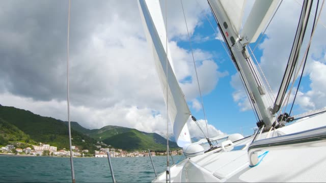 boat sailing in sunny weather  along the coast of Montenegro