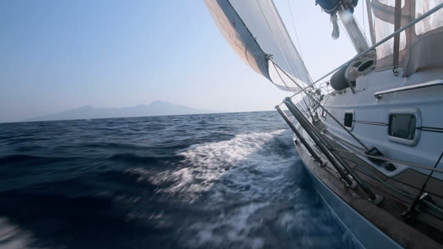 Boat sailing through the waves with good wind video