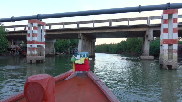 Boat tours through mangrove forests are floating in Khao Daeng Canal, Thailand video