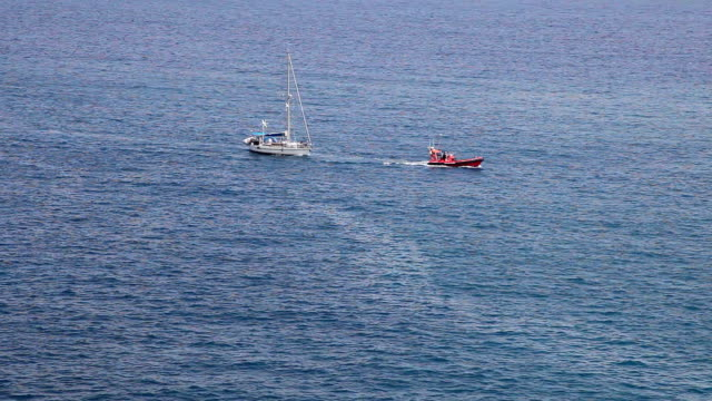 Boat towing yacht video