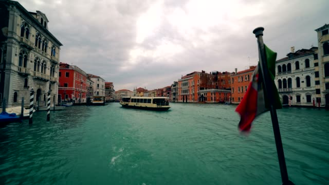 Boat traffic along the Grand canal in Venice with Grand Canal Italy 4K video