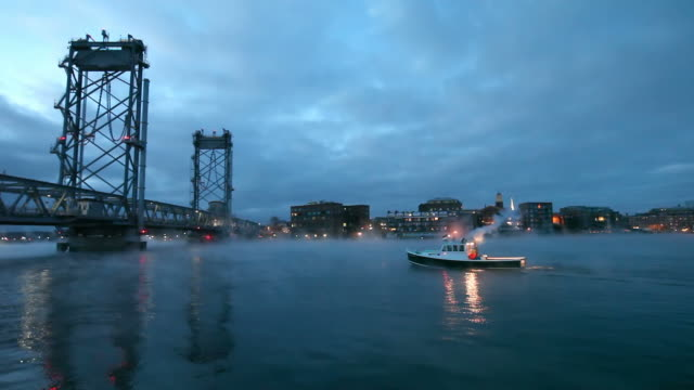 Boat traveling through arctic sea smoke in Portsmouth