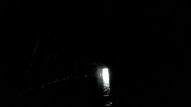 Boat traveling through the limestone cave in Ha Long Bay, Vietnam video