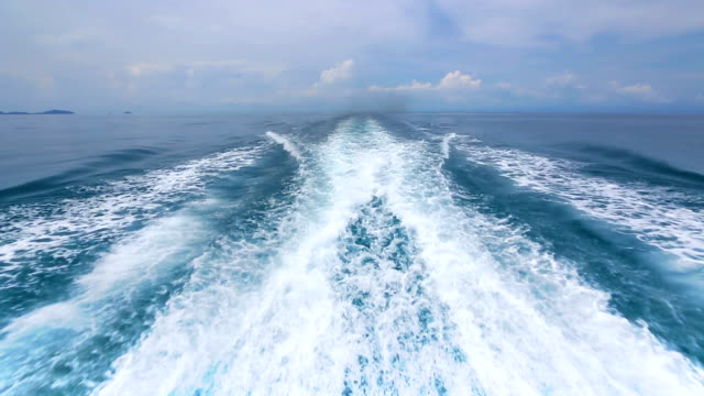 Boat wake on the blue ocean sea video